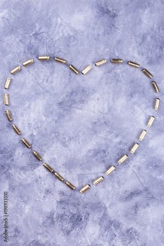 Vászonkép Lined heart of golden bullets