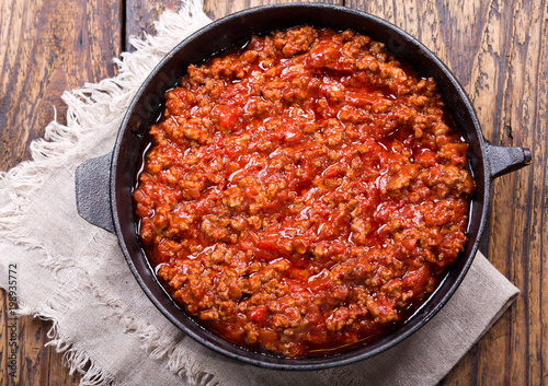 pan of sauce bolognese on wooden table Wallpaper Mural