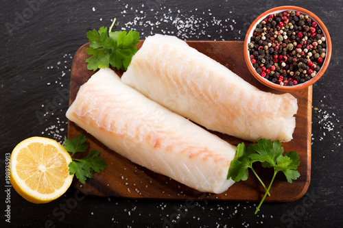 Poster Vis fresh fish fillet with ingredients for cooking