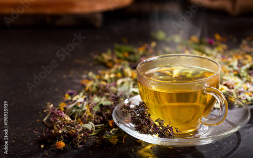 Foto auf Leinwand Tee Cup of herbal tea with various herbs