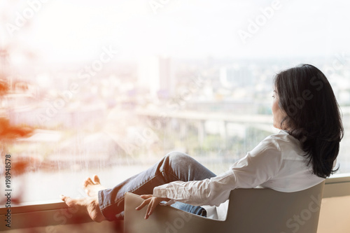Simple healthy living lifestyle menopause aged Asian woman take a rest relaxing Poster Mural XXL