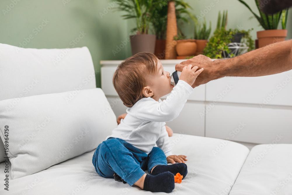 Fototapeta Baby Drinking Water - obraz na płótnie