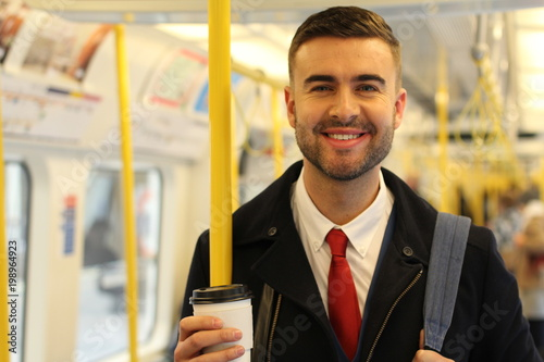 Cheerful businessman using public transportation