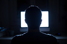 Man Seated In Front Of Compute...