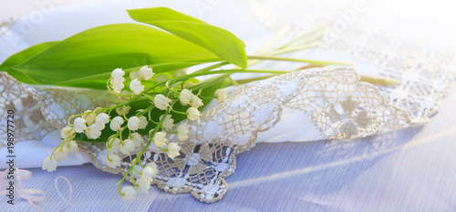 Tuinposter Lelietje van dalen Lily of the valley bouquet on the table.