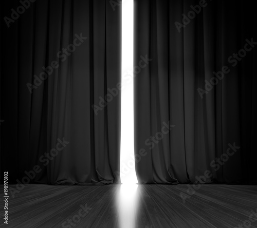 Black curtain background with bright light behind Canvas Print