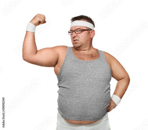 Fotografia  Funny overweight nerd showing off his muscle isolated on white background