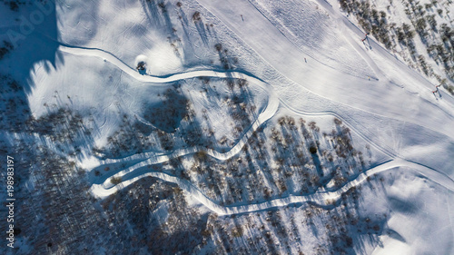 Fotobehang Bergen Drone view of a ski slope in the Alps