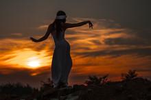 Silhouette Of A Girl Dancing O...