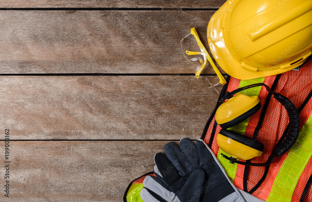 Fototapety, obrazy: Standard construction safety equipment on wooden table. top view