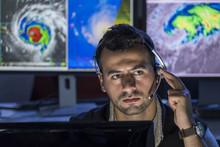 Meteorologist Monitoring Storm...