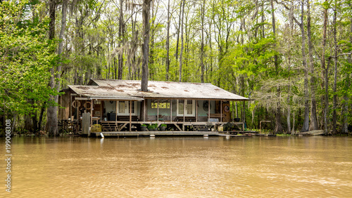 A cajun fish camp in the swamp is gradually being flooded and taken back by the rising waters Wallpaper Mural