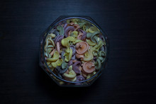Trottoloni Colored Pasta In Glass Jar Isolated On Dark Wooden Background From A High Angle View