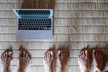 Feet On The Floor With Laptop ...