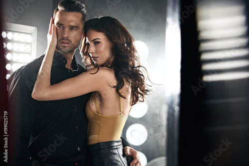 Obraz Closeup portrait of a sensual lady seducing her handsome lover - fototapety do salonu