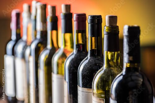 Poster de jardin Bar Line of wine bottles. Close-up.