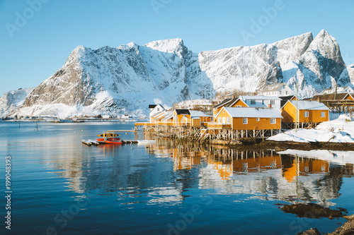 Foto auf Gartenposter Skandinavien Lofoten Islands winter scenery with traditional fisherman Rorbuer cabins, Sakrisoy, village of Reine, Norway