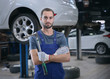 Young mechanic with torque wrench at tire service