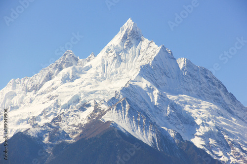Fotografie, Obraz  Kawagarbo snow mountain on a blue sky in Deqin, Yunnan province, China