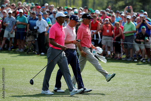 U.S. golfers Woods, Thomas and Couples walk up the 8th fairway ...