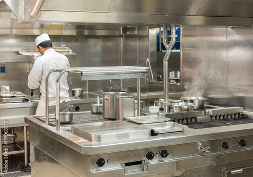 Chef preparing food in commercial kitchen