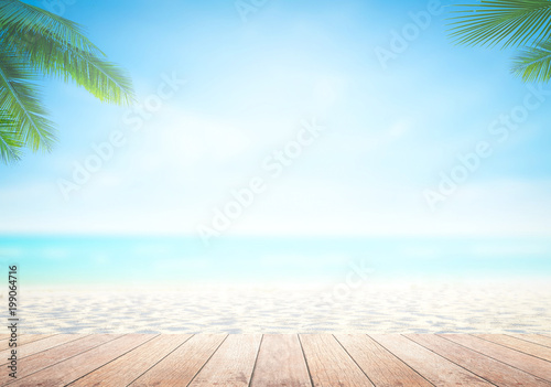 Poster Palmier World environment day concept: Wooden table and the beach background
