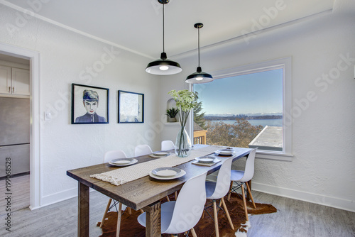Dining room with white walls and wooden table. Poster