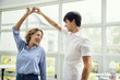 Cheerful couple enjoy dancing together
