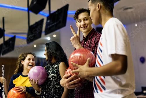 Friends bowling together after school Slika na platnu