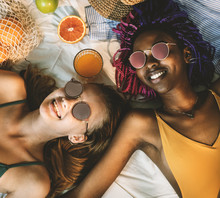 Cheerful Girls In Swimsuit Sun Tanning Together