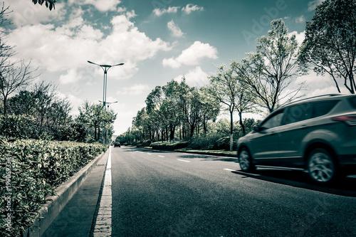 Spoed Foto op Canvas Stadion Car on asphalt road on summer day