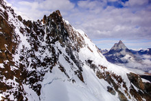 Close Up View Of The North Face Of The Breithorn Near Zermatt With The Matterhorn In The Background