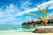Exotic Wooden Huts On The Wate...