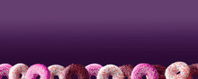 Set Of Purple Donuts On A Purp...