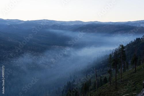 Fototapety, obrazy: Overlooking a smokey mountain valley