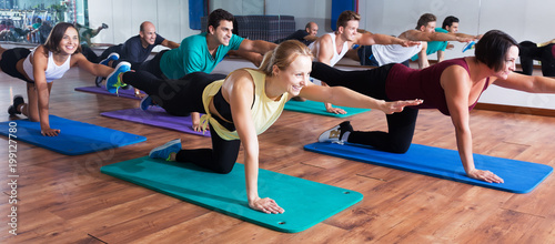 Positive people practicing yoga Wallpaper Mural