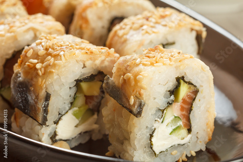 Close Up Uramaki With Conger Sushi Rolls With Nori Rice
