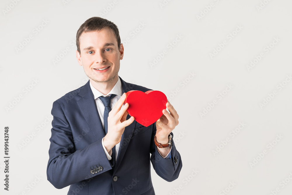 Fototapeta Man holding a heart shape box.