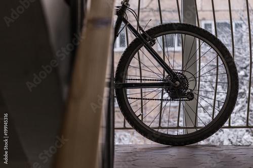 Foto op Aluminium Fiets Bike standing in front of a window in a corridor