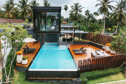 Private tropical swimming pool and gym near luxury villa. Sunny ...