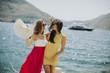 Young women relaxing on sea shore