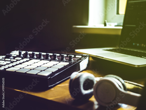 making hip hop beats on the drum machine controller at the home studio Canvas Print