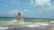 Joyful young pretty woman in bikini running into the sea on sunny summer day. slow motion. 1920x1080
