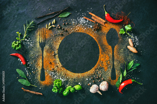 Foto op Aluminium Aromatische Herbs and spices on table with cutlery silhouette
