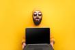 canvas print picture - Trendy man advertising laptop