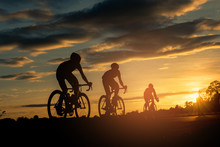 The Men Ride  Bikes At Sunset ...