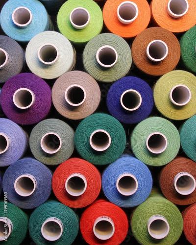 Slika na platnu Colored thread for sewing. Threads in spools