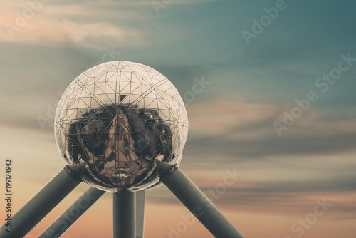 Poster Brussel Atomium in brussels in front of beautiful sunset sky