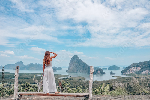 Papiers peints Lieu connus d Asie beautiful girl staying on the top of hill with fantastic panoramic view on beautiful Thai bay