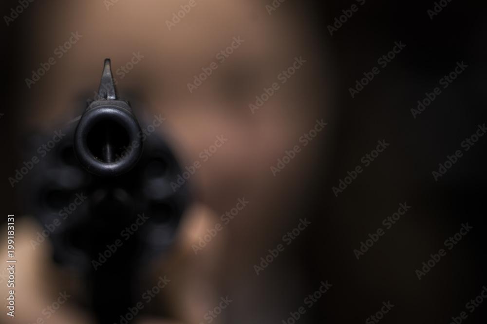 Fototapeta the girl is aiming from the revolver